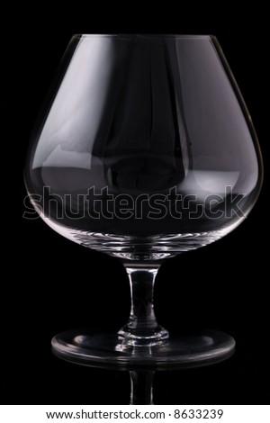 Brandy glass on black background - stock photo