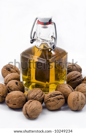 Brandy in old style bottle on white background - stock photo