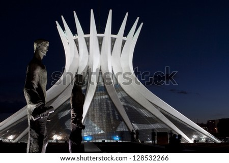 BRASILIA, BRAZIL - FEBRUARY 21: Cathedral of Brasilia at night on February 21, 2009 in Brasilia, Brazil. It was designed by Oscar Niemeyer, and was completed and dedicated on May 31, 1970. - stock photo