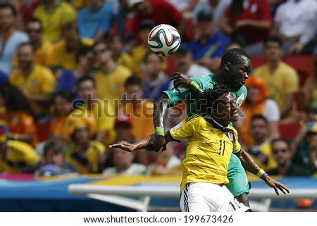 BRASILIA, BRAZIL - June 19, 2014: Cuadrado of Colombia and Diomande of Ivory Coast compete for the ball during the game between Colombia and Ivory Coast at Estadio Nacional. No Use in Brazil