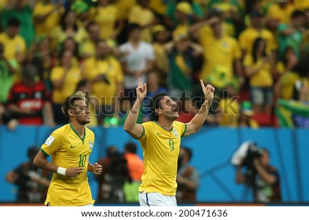 BRASILIA, BRAZIL - June 23, 2014: Fred of Brazil celebrates after scoring a goal during the 2014 World Cup game between Brazil and Cameroon at Estadio Nacional Mane Garrincha. No Use in Brazil.