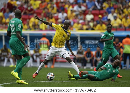 BRASILIA, BRAZIL - June 19, 2014: Ibarbo of Colombia and Zokora of Ivory Coast compete for the ball during the World Cup game between Colombia and Ivory Coast at Estadio Nacional. No Use in Brazil