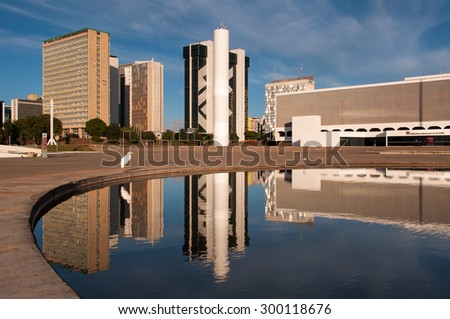 BRASILIA, BRAZIL - JUNE 6, 2015: New Cultural Complex of a Republic - the National Library of Brasilia, with financial buildings behind. - stock photo