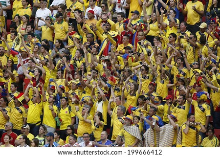 BRASILIA, BRAZIL - June 19, 2014: Soccer fans celebrating at the 2014 World Cup Group C game between Colombia and Ivory Coast at Estadio Nacional. No Use in Brazil. - stock photo