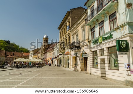 BRASOV, ROMANIA - APRIL 27: Council Square on April 27, 2013 in Brasov, Romania. The Old Town includes the Black Church, Council Square and medieval buildings in different architectural styles.