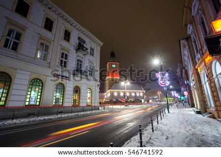 BRASOV, ROMANIA - 15 DECEMBER 2016: Brasov Council House night view decorated for Christmas and traditional winter market in the old town center, Romania
