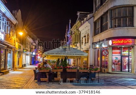 BRASOV, ROMANIA, JULY 9, 2015: Street of the republic is a center of nightlife of romanian city Brasov. During summer is this street flooded by open restaurants and bars.