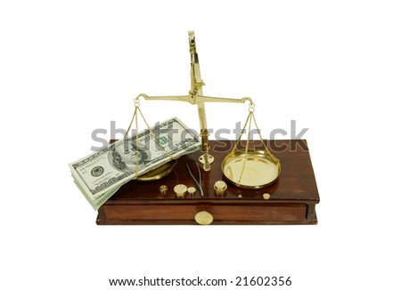 Brass and wood Scale used to weigh out small items and Money in the form of many large bills - stock photo