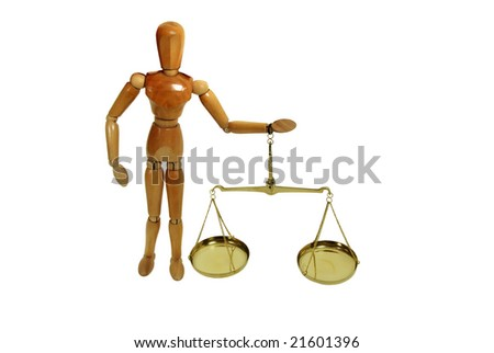 Brass and wood Scale used to weigh out small items held by wooden model representing a person - stock photo