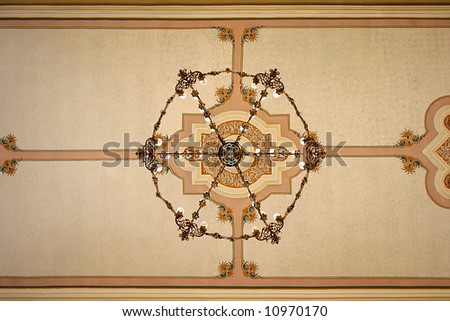 Brass chandelier in an old church. Plock. Poland - stock photo