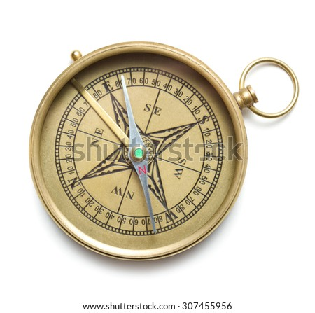 Brass compass isolated on white background - stock photo