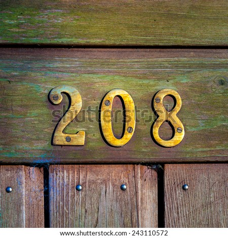 brass house number two hundred and eight - stock photo