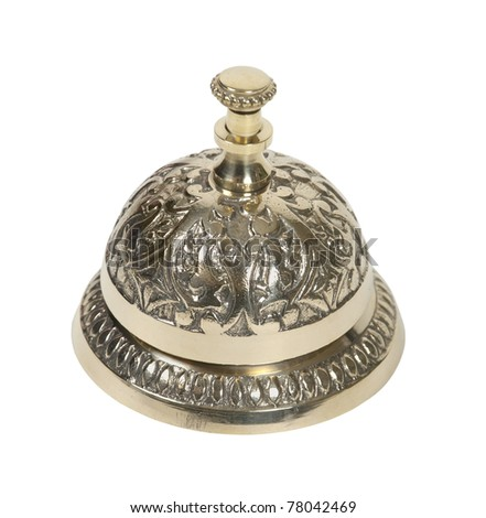 Brass intricate service bell placed on a counter and used to prompt for service - path included - stock photo