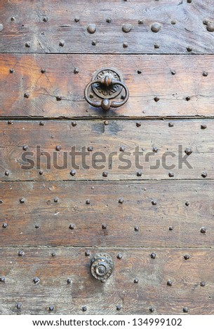 brass knocker and ancient door knocker, travel details in France - stock photo