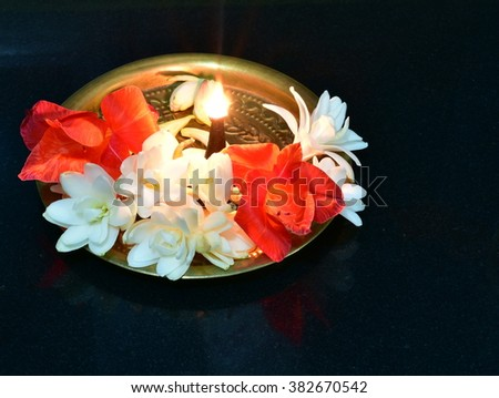 Brass metal plate decorated with pretty flowers with aroma incense, these are puja ritual items for prayers in Hinduism
