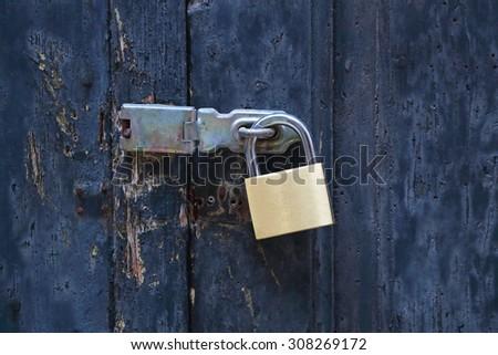 Brass Padlock at Closed Old Door - stock photo
