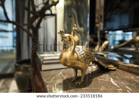 Brass peacock figurine from china - stock photo
