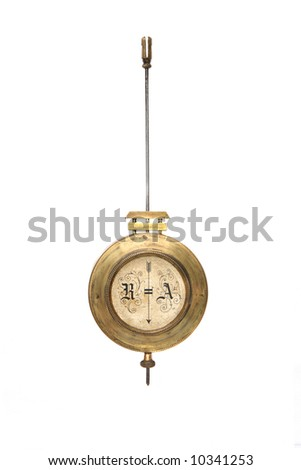 brass pendulum of old wall clock made at early 1900s by J.Unghans - stock photo