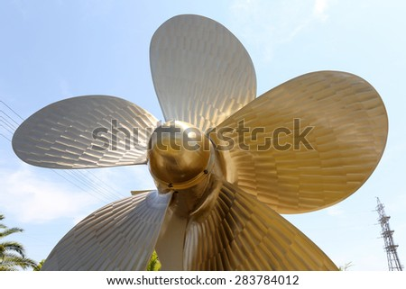 Brass ship screw and blue sky - stock photo