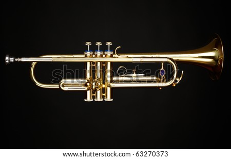 brass trumpet over black background - stock photo