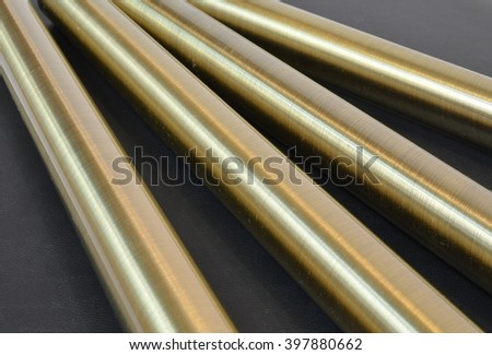 brass tubes on a black background