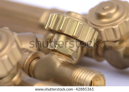 Brass valves on white background. - stock photo