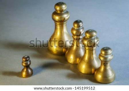 Brass weights of an old weighing scale - weights measured in pounds and ounces - stock photo