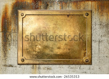 Brass yellow metal plate on grungy concrete background texture - stock photo