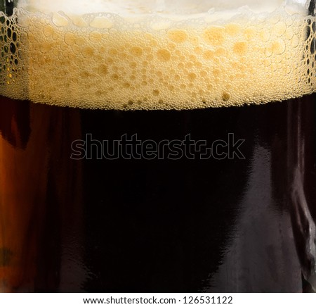 Brasserie foam in the glass. Photo Close-up - stock photo