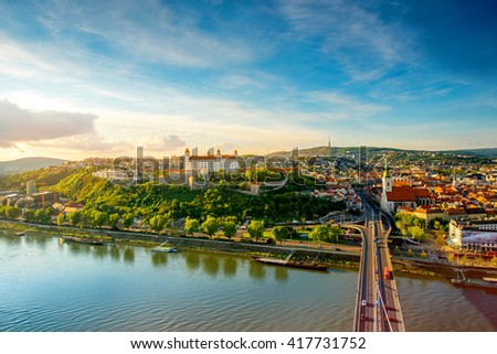 Bratislava aerial cityscape view on the old town with Saint Martin's cathedral, castle hill and Danube river on the sunset in Slovakia. Wide angle view with copy space - stock photo