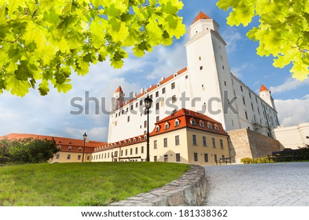 Bratislava castle on sunny day from under the tree - stock photo