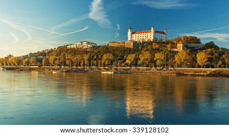 Bratislava castle,parliament and Danube river and beautiful fall day,Slovakia - stock photo