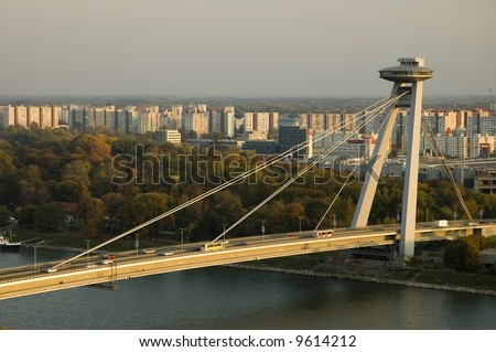 Bratislava's main bridge corssing river Danube. - stock photo