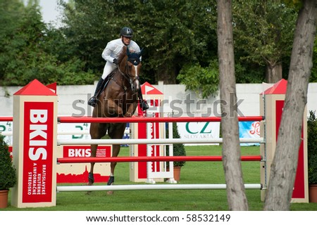 BRATISLAVA, SLOVAKIA - AUGUST 5: DEMEERSMAN Dirk on horse TYMOON CALOO MEERCHEN in action during first round of qualification to Grand Prix CSIO-W*** August 5, 2010 in Bratislava, Slovakia - stock photo