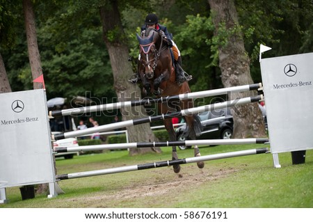 BRATISLAVA, SLOVAKIA - AUGUST 7: KLETTENBERG Gunnar on horse AGADEZ in action during third round of qualification to Grand Prix CSIO-W*** August 7, 2010 in Bratislava, Slovakia - stock photo