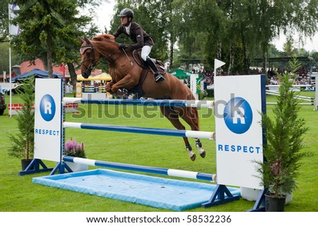 BRATISLAVA, SLOVAKIA - AUGUST 5: OBERTI Giovanni on horse NEWTON DE TURCIS in action during first round of qualification to Grand Prix CSIO-W*** August 5, 2010 in Bratislava, Slovakia - stock photo