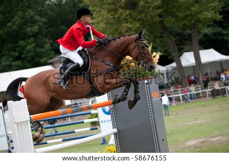 BRATISLAVA, SLOVAKIA - AUGUST 7: OPATRNY Ales on horse TITAN R.S. finished on third place in third round of qualification to Grand Prix CSIO-W*** August 7, 2010 in Bratislava, Slovakia - stock photo