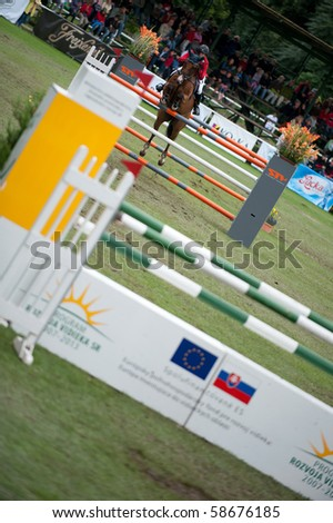 BRATISLAVA, SLOVAKIA - AUGUST 7: RIDER on horse HORSE in action during the third round of qualification to Grand Prix CSIO-W*** August 7, 2010 in Bratislava, Slovakia - stock photo