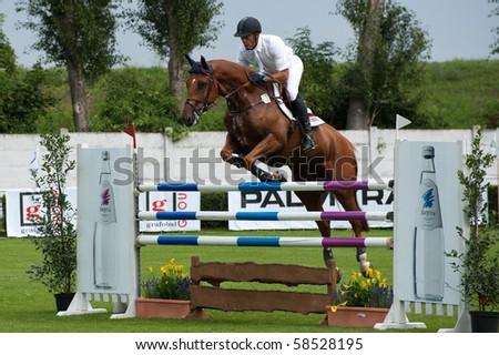 BRATISLAVA, SLOVAKIA - AUGUST 5:  TUGANOV Vladimir on horse BLUEBUSTER in action during first round of qualification to Grand Prix CSIO-W*** August 5, 2010 in Bratislava, Slovakia - stock photo
