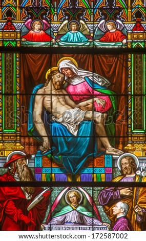 BRATISLAVA, SLOVAKIA - JANUARY 14, 2014: Pieta on windowpane from 19. from manufactures of Karola Geyling and Eduarda Kratzmann in st. Martin cathedral.