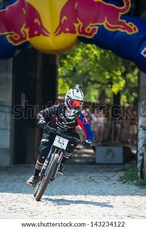 BRATISLAVA, SLOVAKIA - JUNE 22: Lukas Ucen (SVK) on the race track during Bratislava City Downhill on June 22 2013 in Bratislava, Slovakia - stock photo