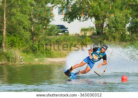 BRATISLAVA, SLOVAKIA - JUNE 26, 2015: Sam de Haan jumps while WakeLake Golden Trophy, Contest of Wake-boarding and Wake-skating