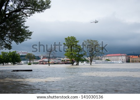 BRATISLAVA, SLOVAKIA - JUNE 4:  The Defence Ministry helicopter  monitors the situation on the Danube river on June 4, 2013 in Bratislava - stock photo