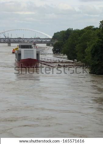 Bratislava, Slovakia - June 5: The water of Danube river flooded Tyrsovo Embankment in Bratislava on June 5th, 2013 - stock photo