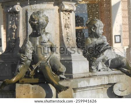 BRATISLAVA, SLOVAKIA - NOVEMBER 1: Ganymede's Fountain in front of Historical Slovak National Theater on November 1, 2013 in Bratislava. It is made by Viktor Oskar Tilgner. - stock photo