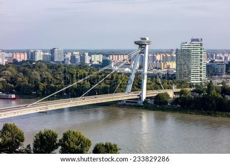 BRATISLAVA, SLOVAKIA - SEPTEMBER 6: Famous Novy Most Bridge across the Danube River in Bratislava, Slovakia on September 6, 2014.  - stock photo