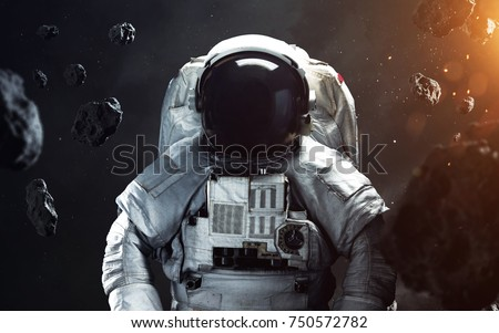 Brave astronaut at the spacewalk. People in space. Elements of this image furnished by NASA