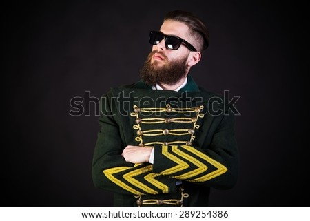 Brave man posing in old outfit and modern sunglasses. - stock photo
