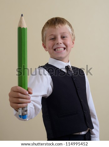 brave schoolboy with big pencil - stock photo
