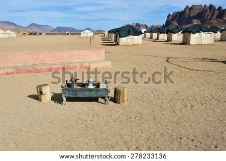 Brazier with utensils in desert camp. Wadi Rum, Jordan - stock photo